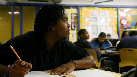 FILE: Dontike Miller, 23, works on math problems at the YouthBuild Public Charter Schools GED program in Washington, Thursday Oct. 25, 2007. (AP Photo/Jacquelyn Martin)