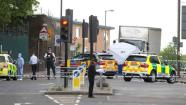 A tent is erected near the scene of an attack in Woolwich southeast London Wednesday, May, 22, 2013. British officials said one person has died and at least two people have been wounded in an attack in southeast London. Scotland Yard said officers responded to reports of an assault Wednesday afternoon in the London neighbourhood of Woolwich. London Ambulance service said one man was found dead at the scene and two other men were taken to the hospital, with one in serious condition. (AP Photo/Alastair Grant)