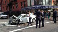In this photo provided by Jan Sichermann, authorities work the scene where eight people were hurt, several of them seriously, after a car jumped a curb and slammed into a 24-hour grocery store, Wednesday, June 19, 2013, in New York. (AP Photo/Jan Sichermann)