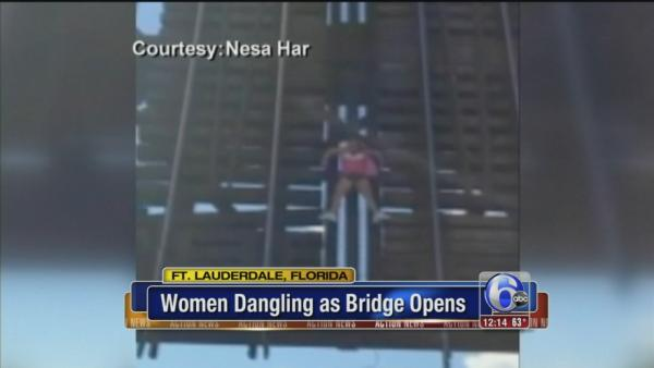 Woman gets trapped on rising bridge