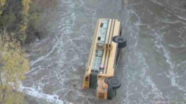 Children rescued after bus topples into creek