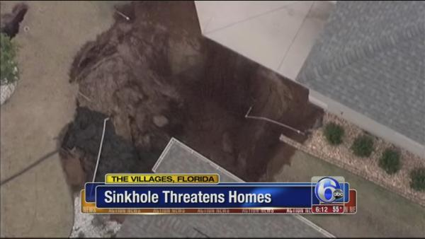 Sinkhole threatens homes in Florida