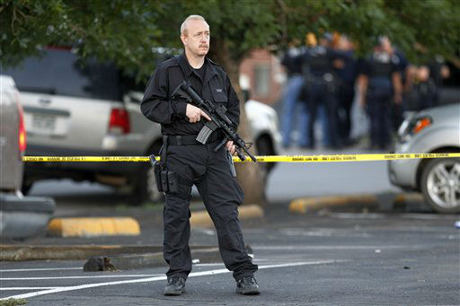A SWAT team officer stands watch near an apartment house where the suspect in a shooting at a movie theatre lived in Aurora, Colo., Friday, July 20, 2012. &#40;AP Photo&#47;Ed Andrieski&#41; <span class=meta>(AP Photo&#47; Ed Andrieski)</span>