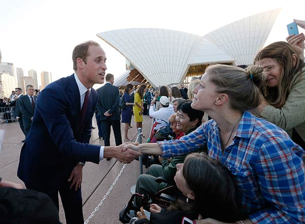"<div class=""meta image-caption""><div class=""origin-logo origin-image ""><span></span></div><span class=""caption-text"">Britain's Prince William, left, meets with people on the steps of the Sydney Opera House following a reception in Sydney Wednesday, April 16, 2014. Prince William and his wife Kate, the Duchess of Cambridge, are on an official visit to New Zealand and Australia with their son, Prince George. (AP Photo/Jason Reed, Pool)</span></div>"