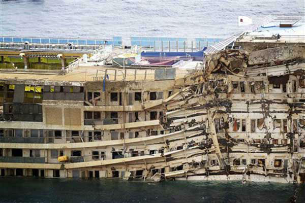 The Costa Concordia is seen being lifted upright on the Tuscan Island of Giglio, Italy, Tuesday, Sept. 17, 2013.  &#40;AP Photo&#47;Andrea Sinibaldi, Lapresse&#41; <span class=meta>(Photo&#47;Alessandro La Rocca)</span>