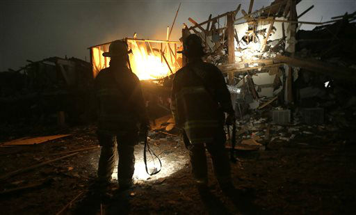 "<div class=""meta ""><span class=""caption-text "">Firefighters us flashlights to search a destroyed apartment complex near a fertilizer plant that exploded earlier in West, Texas, in this photo made early Thursday, April 18, 2013.   (AP Photo/ LM Otero)</span></div>"