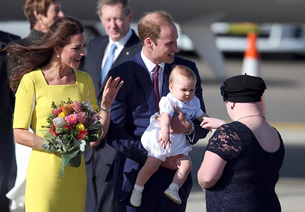 "<div class=""meta image-caption""><div class=""origin-logo origin-image ""><span></span></div><span class=""caption-text"">Britain's Prince William, center, his wife Kate, the Duchess of Cambridge, left, and their son Prince George are presented with flowers by Joscelyn Sweeney upon arrival at Sydney, Australia, Wednesday, April 16, 2014. The royal family kicked off their tour of Australia. (AP Photo/Rob Griffith)</span></div>"