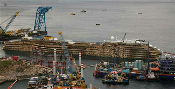 "<div class=""meta ""><span class=""caption-text "">The Costa Concordia is seen being lifted upright on the Tuscan Island of Giglio, Italy, Tuesday, Sept. 17, 2013.  (AP Photo/Andrea Sinibaldi, Lapresse) (Photo/Andrew Medichini)</span></div>"