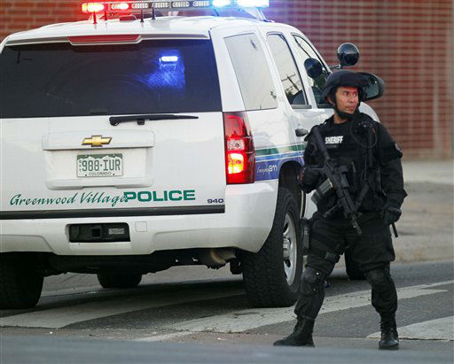 "<div class=""meta ""><span class=""caption-text "">A SWAT team officer stands watch near an apartment house where the suspect in a shooting at a movie theatre lived in Aurora, Colo., Friday, July 20, 2012. (AP Photo/Ed Andrieski) (AP Photo/ Ed Andrieski)</span></div>"