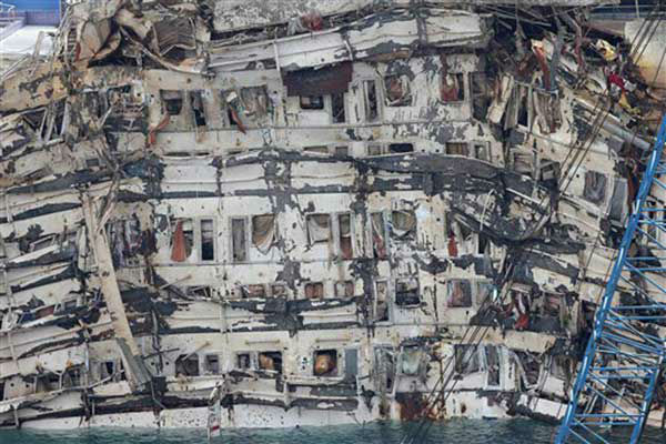 The Costa Concordia is seen being lifted upright on the Tuscan Island of Giglio, Italy, Tuesday, Sept. 17, 2013.  &#40;AP Photo&#47;Andrea Sinibaldi, Lapresse&#41; <span class=meta>(Photo&#47;Andrea Sinibaldi)</span>