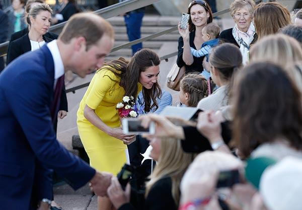 "<div class=""meta image-caption""><div class=""origin-logo origin-image ""><span></span></div><span class=""caption-text"">Britain's Prince William, left, and his wife Kate, the Duchess of Cambridge, second from left, meet with people on the steps of the Sydney Opera House following a reception in Sydney Wednesday, April 16, 2014. The royal couple are on an official visit to New Zealand and Australia with their son Prince George. (AP Photo/Jason Reed, Pool)</span></div>"