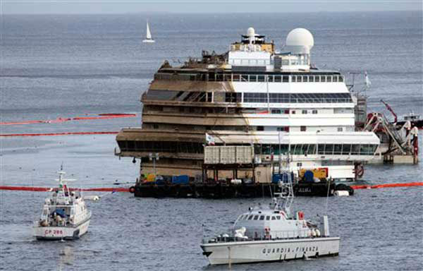 The Costa Concordia is seen being lifted upright on the Tuscan Island of Giglio, Italy, Tuesday, Sept. 17, 2013.  &#40;AP Photo&#47;Andrea Sinibaldi, Lapresse&#41; <span class=meta>(Photo&#47;Andrew Medichini)</span>