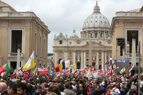 Flags from nations around the world fly over the crowd in front of St. Peter?s Square <span class=meta>(Photo&#47;John Morris)</span>