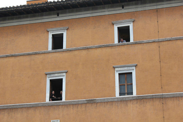 Watching the canonization from the windows along Via della Conciliazione  <span class=meta>(Photo&#47;John Morris)</span>
