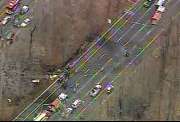 Rescue crews on the scene of the crash of a small aircraft along I-287 in Morris County, New Jersey on December 20, 2011.