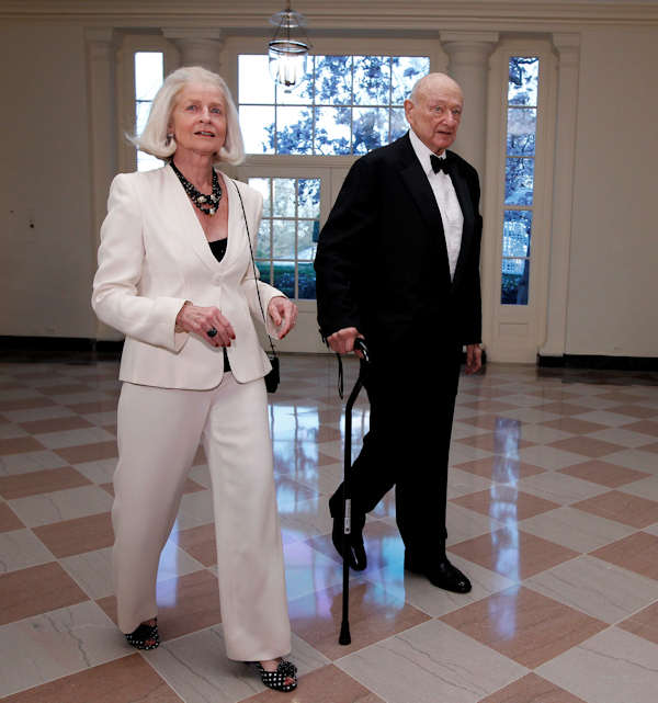 Former New York City Mayor Ed Koch and Diane Mulcahy arrive at the Booksellers area of the White House in Washington for the State Dinner hosted by President Barack Obama and first lady Michelle Obama for British Prime Minister David Cameron and his wife Samantha, Wednesday, March 14, 2012. (AP Photo/Charles Dharapak)