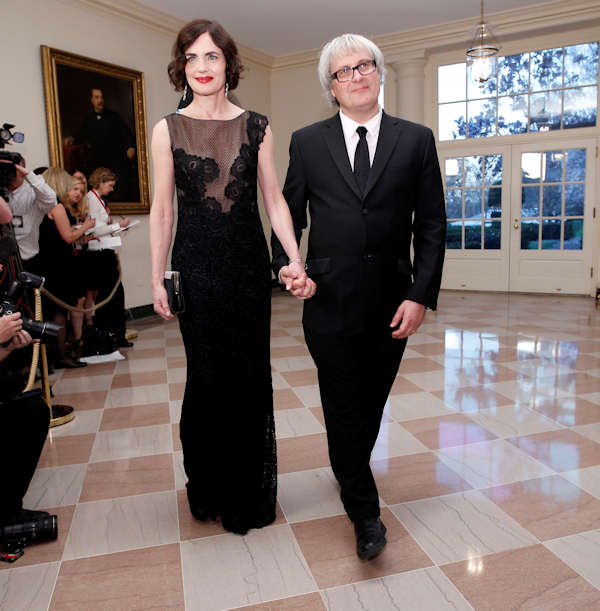 "<div class=""meta image-caption""><div class=""origin-logo origin-image ""><span></span></div><span class=""caption-text"">Actress Elizabeth Lee McGovern, left, and Simon Adam Curtis arrive at the Booksellers area of the White House in Washington for the State Dinner hosted by President Barack Obama and first lady Michelle Obama for British Prime Minister David Cameron and his wife Samantha, Wednesday, March 14, 2012. (AP Photo/Charles Dharapak)</span></div>"