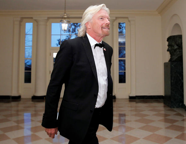 Sir Richard Branson arrives at the Booksellers area of the White House in Washington for the State Dinner hosted by President Barack Obama and first lady Michelle Obama for British Prime Minister David Cameron and his wife Samantha, Wednesday, March 14, 2012. (AP Photo/Charles Dharapak)