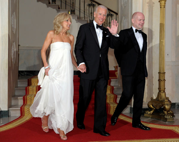 Vice President Joe Biden, his wife Jill Biden, left, and Foreign Secretary William Hague, right, arrive at the White House in Washington, Wednesday, March 14, 2012, before the State Dinner. (AP Photo/Susan Walsh)