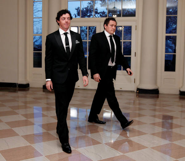 Professional golfer Rory McIlroy and Conor Ridge arrive at the Booksellers area of the White House in Washington for the State Dinner hosted by President Barack Obama and first lady Michelle Obama for British Prime Minister David Cameron and his wife Samantha, Wednesday, March 14, 2012. (AP Photo/Charles Dharapak)