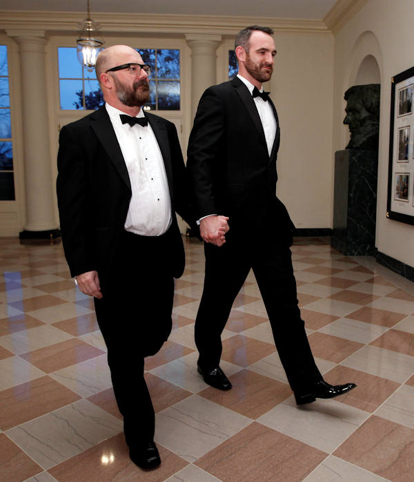 Andrew Sullivan of Newsweek/Daily Beast, left, and Aaron Tone arrive at the Booksellers area of the White House in Washington for the State Dinner hosted by President Barack Obama and first lady Michelle Obama for British Prime Minister David Cameron and his wife Samantha, Wednesday, March 14, 2012. (AP Photo/Charles Dharapak)