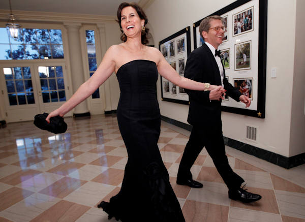 White House Press Secretary Jay Carney walks with his wife, Claire Shipman of ABC News, as they arrive at the Booksellers area of the White House in Washington for the State Dinner hosted by President Barack Obama and first lady Michelle Obama for British Prime Minister David Cameron and his wife Samantha, Wednesday, March 14, 2012. (AP Photo/Charles Dharapak)