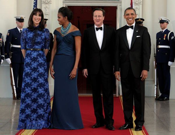 President Barack Obama and first lady Michelle Obama pose for photographers with British Prime Minister David Cameron and his wife Samantha Cameron as they arrive in the North Portico of the White House for a State Dinner, Wednesday, March 14, 2012, in Washington. (AP Photo/Susan Walsh)