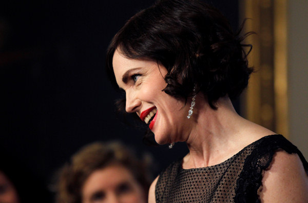 Actress Elizabeth McGovern speaks to reporters as she arrives at the Booksellers area of the White House in Washington for the State Dinner hosted by President Barack Obama and first lady Michelle Obama for British Prime Minister David Cameron and his wife Samantha, Wednesday, March 14, 2012. (AP Photo/Charles Dharapak)