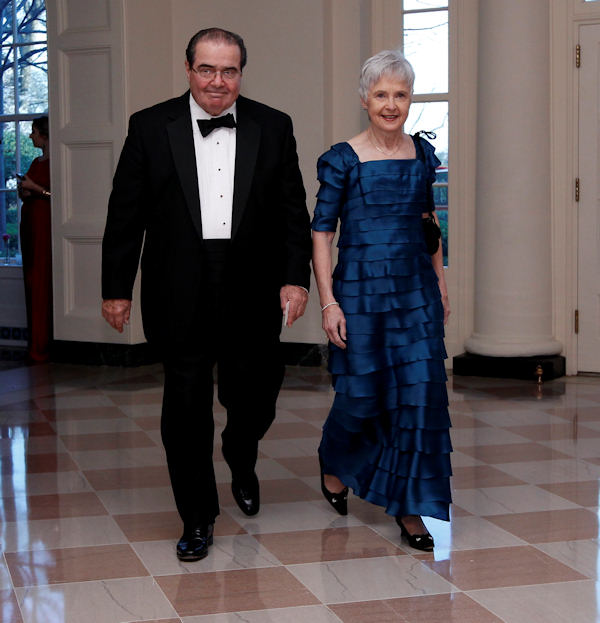 Supreme Court Justice Antonin Scalia and his wife Maureen arrive at the Booksellers area of the White House in Washington for the State Dinner hosted by President Barack Obama and first lady Michelle Obama for British Prime Minister David Cameron and his wife Samantha, Wednesday, March 14, 2012. (AP Photo/Charles Dharapak)