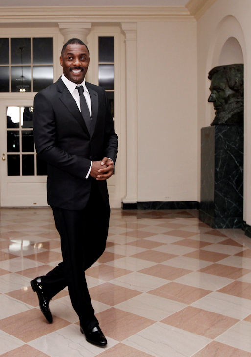 Actor Idris Elba arrives at the Booksellers area of the White House in Washington for the State Dinner hosted by President Barack Obama and first lady Michelle Obama for British Prime Minister David Cameron and his wife Samantha, Wednesday, March 14, 2012. (AP Photo/Charles Dharapak)