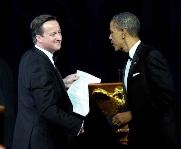 President Barack Obama shakes hands with British Prime Minister David Cameron in between toasts during a State Dinner at the White House in Washington, Wednesday, March 14, 2012. (AP Photo/Susan Walsh)