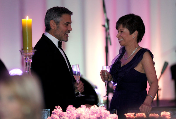 Actor George Clooney, left, talks with Senior White House Adviser Valerie Jarrett, right, before the State Dinner with President Barack Obama and British Prime Minister David Cameron at the White House in Washington, Wednesday, March 14, 2012. (AP Photo/Susan Walsh)