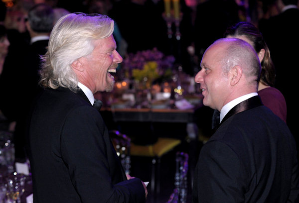Sir Richard Branson, left, talks with Steve Hilton, who was the director of strategy for British Prime Minister David Cameron, before the State Dinner with President Barack Obama and Cameron at the White House in Washington, Wednesday, March 14, 2012. (AP Photo/Susan Walsh)