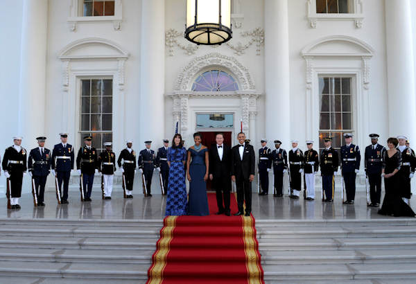 President Barack Obama and first lady Michelle Obama pose for photographers with British Prime Minister David Cameron and his wife Samantha Cameron as they arrive in the North Portico of the White House prior to a State Dinner, Wednesday, March 14, 2012, in Washington. (AP Photo/Susan Walsh)