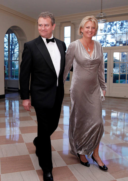 British actor Hugh Bonneville and LuLu Williams arrive at the Booksellers area of the White House in Washington for the State Dinner hosted by President Barack Obama and first lady Michelle Obama for British Prime Minister David Cameron and his wife Samantha, Wednesday, March 14, 2012. (AP Photo/Charles Dharapak)