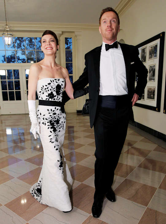 British actors Damian Lewis and Helen McCrory arrive at the Booksellers area of the White House in Washington for the State Dinner hosted by President Barack Obama and first lady Michelle Obama for British Prime Minister David Cameron and his wife Samantha, Wednesday, March 14, 2012. (AP Photo/Charles Dharapak)
