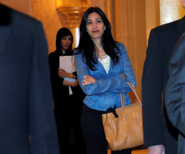 Huma Abedin, aide to Secretary of State Hillary Rodham Clinton, heads to a meeting at the Emirates Palace Hotel in Abu Dhabi, United Arab Emirates, Thursday, June 9, 2011. Abedin is married to Rep. Anthony Weiner, D-N.Y. (AP Photo/Susan Walsh, Pool)