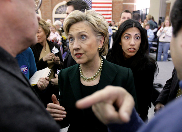 Democratic presidential hopeful Sen. Hillary Rodham Clinton, D-N.Y., talks with supporters after she speaks at a campaign stop Sunday, Dec. 16, 2007, in Council Bluffs, Iowa. At right, Clinton campaign manager Huma Abedin. (AP Photo/M. Spencer Green)