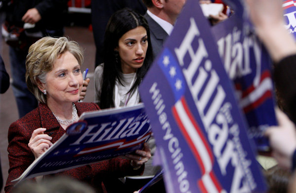 Democratic presidential hopeful, Sen. Hillary Rodham Clinton, D-N.Y., is accompanied by aide Huma Abedin as she greets supporters at a campaign rally in Millersville, Pa., Tuesday, March 18, 2008. (AP Photo/Charles Dharapak)