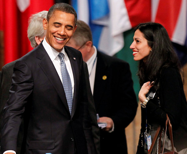 U.S. President Barack Obama, left, speaks with Huma Abedin, an aide in U.S. Secretary of State Hillary Rodham Clinton's cabinet, during a round table meeting of the North Atlantic Council during a NATO summit in Lisbon on Friday, Nov. 19, 2010.  (AP Photo/Armando Franca)