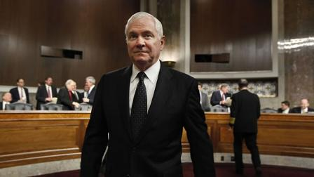 Defense Secretary Robert Gates arrives on Capitol Hill in Washington.