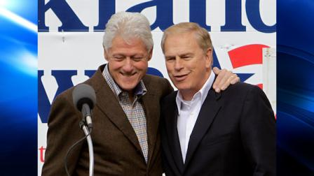 Former President Bill Clinton embraces Ohio Gov. Ted Strickland, right, during a campaign rally in Canton, Ohio Saturday, Oct. 30, 2010. (AP Photo/Mark Duncan)