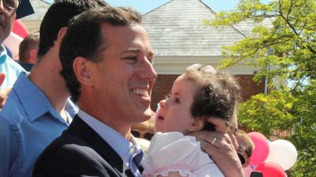 Former Pennsylvania Sen. Rick Santorum holds his daughter Isabella before announcing he is entering the Republican presidential race, Monday, June 6, 2011, on the steps of the Somerset County Courthouse in Somerset, Pa. (AP Photo/Gene J. Puskar)