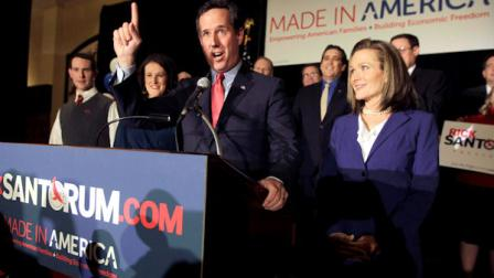 Republican presidential candidate former Pennsylvania Sen. Rick Santorum speaks as his wife Karen, right, listens during a primary night watch party Tuesday, Feb. 7, 2012, in St. Charles, Mo. (AP Photo/Jeff Roberson)