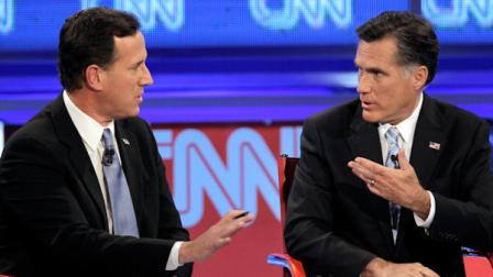 Republican presidential candidate, former Massachusetts Gov. Mitt Romney, right, debate a point with former Pennsylvania Sen. Rick Santorum during a Republican presidential debate Wednesday, Feb. 22, 2012, in Mesa, Ariz. (AP Photo/Jae C. Hong)