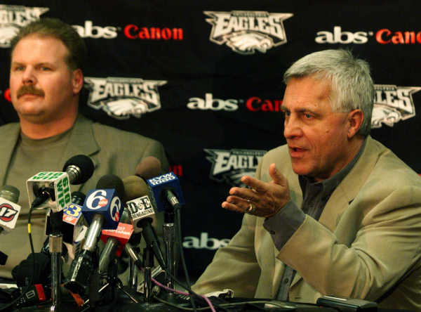 Philadelphia Eagles coach Andy Reid, left, listens as Eagles general manager Tom Modrak responds to a question during a press conference Thursday, Jan. 6, 1999 in Philadelphia. (AP Photo)