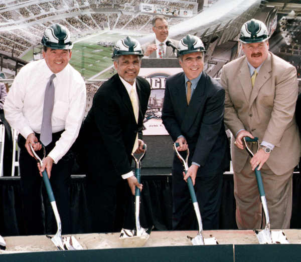 Pennsylvania Gov. Tom Ridge, Philadelphia Mayor John Street, Eagles owner Jeffrey Lurie and Eagles coach Andy Reid, from left, prepare their shovels for the groundbreaking of the new Eagles stadium Thursday, June 7, 2001, in Philadelphia. This will be the first time in the 68-year history of the franchise that the team will have its own stadium. (AP Photo/Delane Rouse)