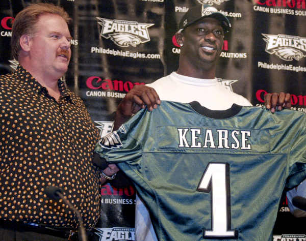 Former Tennessee Titan defensive end Jevon Kearse poses with Philadephia Eagles coach Andy Reid, left, Thursday, March 4, 2004, in Philadelphia. The three-time Pro Bowler passed a physical Thursday and will join the Eagles to fill the team's biggest need on defense. Kearse and the Eagles agreed to a $66 million, eight-year contract on Wednesday, the first day of the NFL's free agency period.(AP Photo/H. Rumph, Jr.)