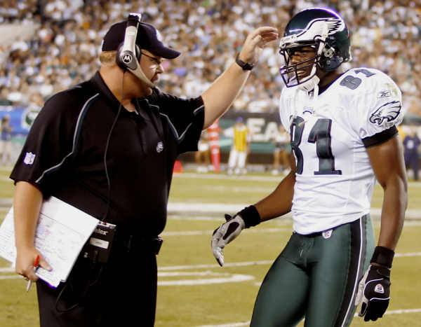 Philadelphia Eagles coach Andy Reid, left, has a word with receiver Terrell Owens (81) in the first quarter against the Cincinnati Bengals, Friday, Aug. 26, 2005, in Philadelphia. (AP Photo/Rusty Kennedy)