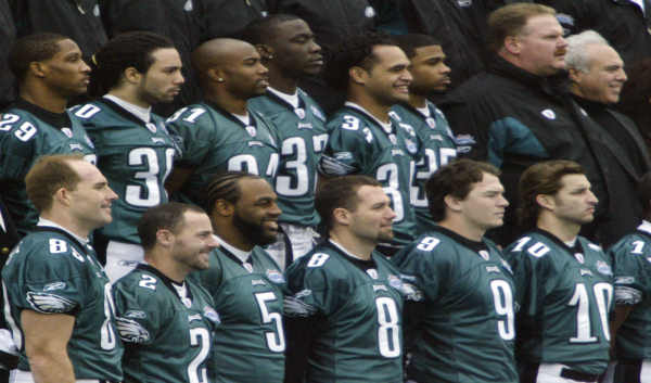 Members of the Philadelphia Eagles football team pose for a team portrait following Media Day at Alltel Stadium in Jacksonville, Fla., on Tuesday, Feb. 1, 2005. Top row from left: Roderick Hood (29), J.R. Reed (30), Dexter Wynn (31), Michael Lewis (32), Reno Mahe (34), Bruce Perry (35), coach Andy Reid and owner Jeffrey Lurie. Bottom row from left: Mike Bartrum (88), David Akers (2), Donovan McNabb (5), Dirk Johnson (8), Andy Hall (9) and Koy Detmer (10). (AP Photo/Stephan Savoia)